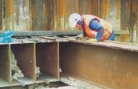Each I-beam installed was carefully aligned using interlocking steel profiles.