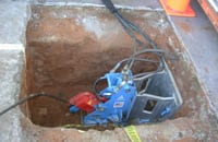 The Underground Solutions crew was able to burst and replace 120-foot, 4-inch cast iron lateral line with 4-inch HDPE using static bursting. Through the static process, the crew was able to overcome a 45-degree bend in the exiting line.