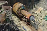 The Boyer crew utilized a 24-inch diameter Grundoram Taurus pipe rammer to install the 66-inch diameter casing underneath the rail line. The casing functioned as a bypass siphon for a water canal while the original siphon was under repair.
