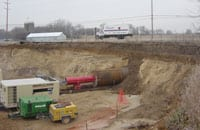 Once in place, the 150-ft casing would facilitate the expansion of a gravel operation. A conveyor system will be placed through casing to carry gravel from a new pit on one side of the highway to the crushing facility on the other.