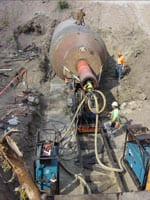 The crew used a Grundoram Taurus pneumatic pipe rammer from trenchless equipment manufacturer TT Technologies, Aurora, Ill. At 24 inches in diameter, the Taurus is the world's second largest pipe rammer. The 32-inch Grundoram Apollo is the world's largest.