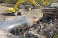 The giant casing was rammed 60 feet under Iowa Interstate Railroad tracks. The tracks remained open during the ramming operations. The casing was installed to create a tunnel under the tracks for a new bike path for the city of Altoona Iowa.