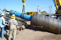For the 4003-foot Gila River crossing (Phoenix, Ariz.), The Crossing Company installed a 60-inch Conductor Barrel® casing at the beginning of the bore. Crews used a 24-inch Grundoram Taurus to install the casing.