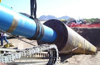 During the conductor barrel process, a casing is rammed into the ground, at a predetermined angle, until desirable soil conditions are met. The spoil is removed from the casing with an auger or core barrel.