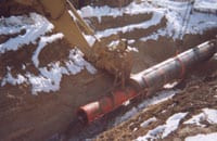 The US Pipeline utilized the slick-bore process over 60 times during the 28 mile Horizon Pipeline project. The process involves installing a bore pipe with a pneumatic Grundoram pipe rammer (shown here), then attaching the product pipe to the bore pipe. As the bore pipe is removed with a winch, the product pipe is pulled into place.