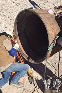Welding the cutting shoe on pipe.
